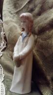 Porcelanowa dziewczynka sygnowana