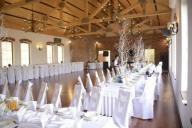 Białe pokrowce na krzesła ślub wesele - wynajem