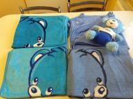 Śliczne kocyki, ręcznik i miś Nestle