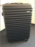 Duża, czarna walizka firmy WITTCHEN
