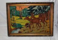 Gobelin-sarna z jeleniem w lesie- w złotej ramie.