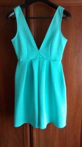 Miętowa sukienka z dekoltem V w rozmiarze S