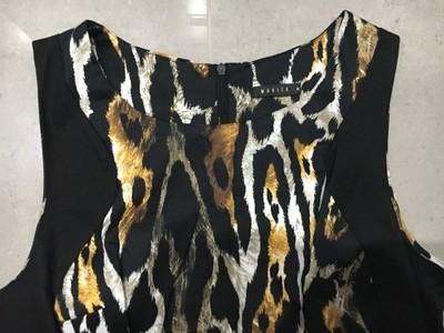 Cudna sukienka panterka Mohito 40/L